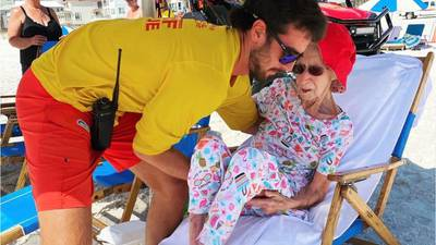 Alabama lifeguards carry 95-year-old beachgoer to her spot every day